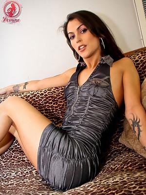 Sexy Tgirl Domino Presley fingers her tight backside!